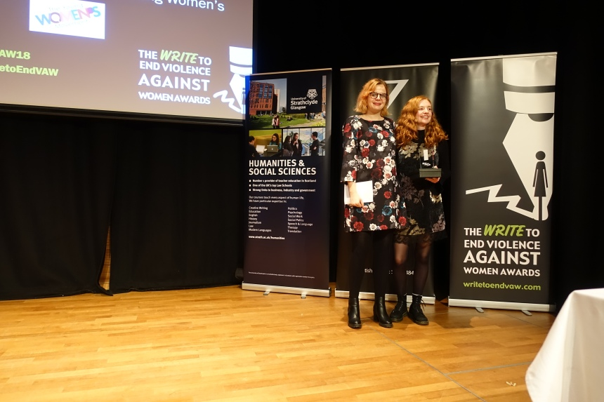 Patrycja Kupiec standing with Rosie Hilton. Rosie is smiling and holding a trophy.